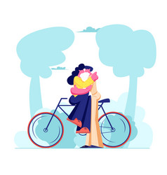 young loving couple sitting on bicycle and kissing vector image