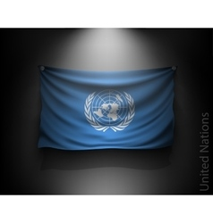 waving flag United Nations on a dark wall vector image