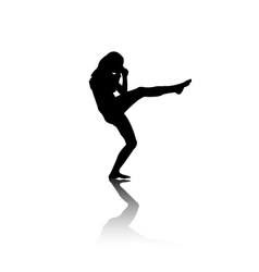 Silhouette of woman kicking vector image