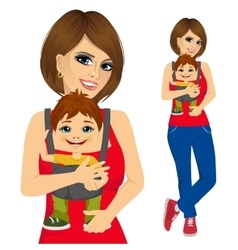 mother holding little boy with baby carrier vector image
