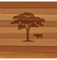 Silhouette of rhino and tree vector image vector image