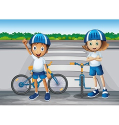 A girl and a boy with their bikes standing near vector image