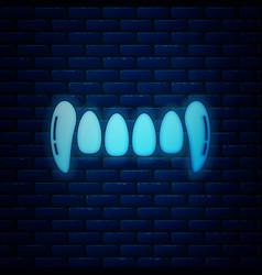 Glowing neon vampire teeth icon isolated on brick vector
