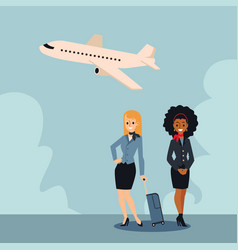 two beautiful stewardesses with a suitcase stand vector image