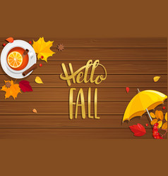Hello fall lettering on wooden background vector