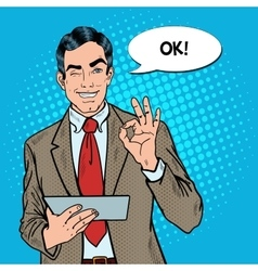 Pop art businessman with tablet gesturing ok vector