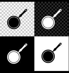 Frying pan icon isolated on black white and vector