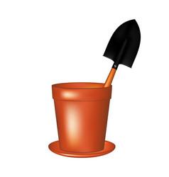 Garden trowel in terracotta flowerpot vector