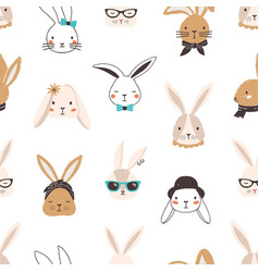 Childish seamless pattern with funny bunny faces vector