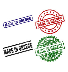 Damaged textured made in greece stamp seals vector