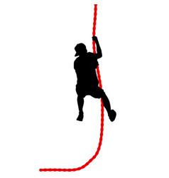 black silhouette mountain climber climbing a vector image