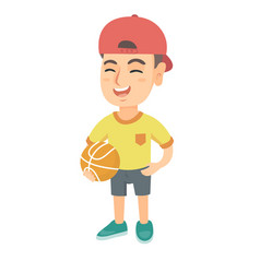 laughing schoolboy holding a basketball ball vector image