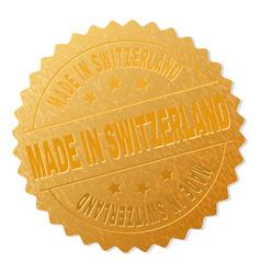 Gold made in switzerland award stamp vector