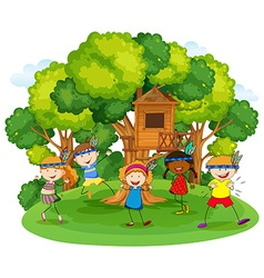 Children playing red indians in the garden vector image vector image
