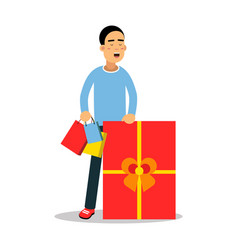 Young man standing with purchases and huge red vector
