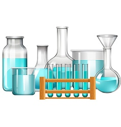 Glass beakers and test tubes with blue liquid vector image