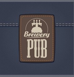 Leather label for brewery or pub on denim backdrop vector