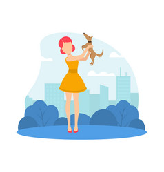 young woman holding cute puppy girl walking vector image