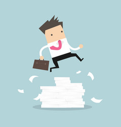 businessman jumping over large stack of documents vector image