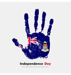 Handprint with the Flag of Cayman Islands in vector