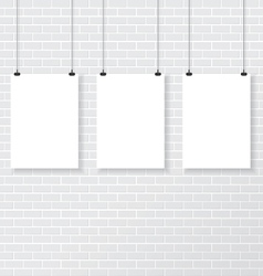 Three white poster on brick wall vector image