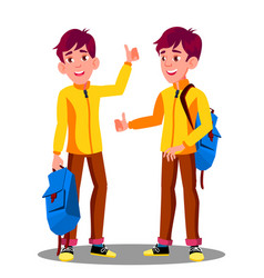 boy with school bag holding thumb up vector image