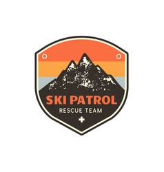 Vintage hand drawn mountain ski patrol emblem vector