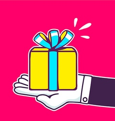 hand holding yellow gift box with blue ri vector image vector image
