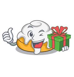 With gift cinnamon roll mascot cartoon vector