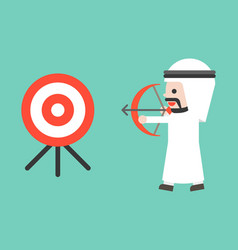 Arab business man drawing bow to shooting target vector