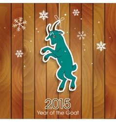 Green goat decoration on a wooden background vector image vector image