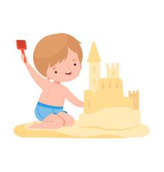 cute boy building sandcastle kids summer vector image