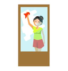 cheerful woman wiping window vector image