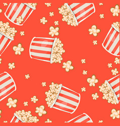 seamless pattern with popcorn on a red background vector image