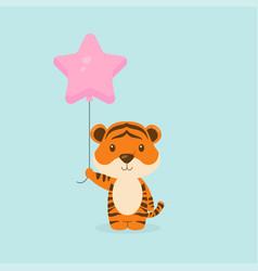 Cute tiger holding balloon free vector