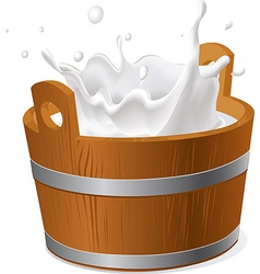 wooden bucket with milk splash isolated on white vector image