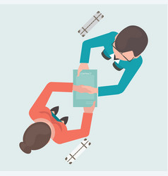 top view of two people shaking their hands vector image