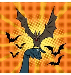 Evil bat sitting on the hand vector