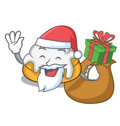 Santa with gift cinnamon roll mascot cartoon vector