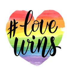 Love wins lettering on watercolor rainbow spectrum vector