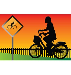 young cyclists evening at the signs vector image vector image