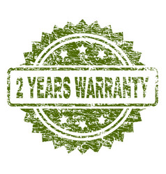 Scratched textured 2 years warranty stamp seal vector