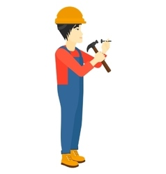 Man hammering nail vector