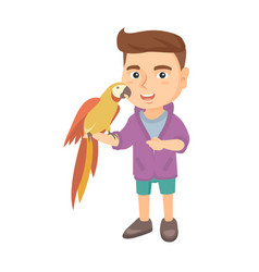 caucasian little boy holding parrot on his hand vector image