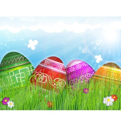 Painted Easter eggs on meadow vector image
