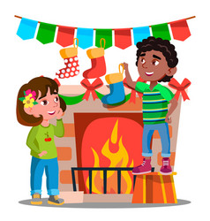 two kids hanging christmas socks on decorated vector image