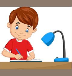 cartoon little boy studying on table vector image