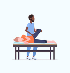 Young girl lying on massage bed african american vector