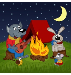 animals resting around bonfire vector image