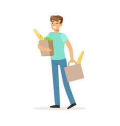 young smiling man carrying two bags with food vector image
